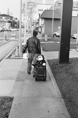 Monkey Got My Back (louiseven) Tags: street monkey losangeles 50mm18d nikonf100 hp5 ilford bw