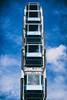 people in boxes (Al Fed) Tags: 20171015 stuttgart volksfest wasen ferries wheel black blue people boxes sky clouds