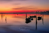 RED SUNSET TERMINAL (Stephen Hunt61) Tags: sunset boats sky red water sea adriatic reflections docks landscape landscapes seascape seascapes coast coastline gulf italy salty tourism nobody buildings barche tramonto acqua mare spiaggia stefanocaccia