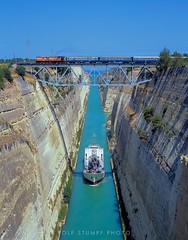 Korinthos Canal (rolfstumpf) Tags: greece isthmos korinthos canal trains passengertrain ose organismossidirodromonellados a9105 alco dl537 bridge water ocean transport rock engineering summer peloponnese metergauge narrowgauge mamiya fujichrome astia 645super travel truss steel