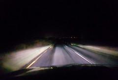 Time Flies... (Michael C. Hall) Tags: drive night car windscreen movement blur road headlight light bright