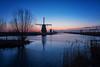 The Kinderdijk blues (reinaroundtheglobe) Tags: kinderdijk zuidholland nederland holland dutch dutchlandscape landscape windmill traditionalwindmill bluehour morning water winter traveldestination travelphotography touristdestination touristattraction
