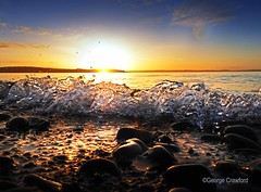 Largs Sunset Small Wave and Pebbles1 (g crawford) Tags: crawford ayrshire northayrshire largs clyde riverclyde firthofclyde cumbrae bigcumbrae water sunset sundown gloaming reflect reflection reflected orange yellow wave splash pebble pebbles light