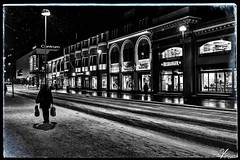 Street Life 00.15 (ViTaRu) Tags: canon 6d 35f14l urban city cityscape evening night nighttime nightlights nightshot noir mood winter people walking snow ice bags facade retail hesburber centrum varsinaissuomi turku finland monochrome road sign
