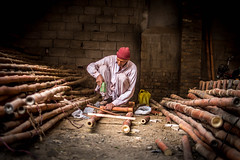 Making bamboo ladder ..... (impressionsbyatifm) Tags: streetphotography street streetportraits pakistan portrait people faces life bamboo hardwork ladder streetlife rawalpindi
