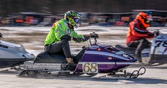 In The Passing Lane (Wes Iversen) Tags: michigan nikkor18300mm stcharles blur drivers ice men motion motionblur panning people racing snow snowmobileracing snowmobiles tracks vintage winter