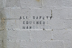 Safety Mandatory (Restless Eye) Tags: southknoxville tennessee usa stencil concrete block sign safe risk skate inline rink abandoned