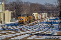 UP 7705 | GE AC45CCTE | UP Memphis Subdivision (M.J. Scanlon) Tags: up7705 ge ac45ccte up upmemphissub unionpacific broadway tower17 csxmemphisterminalsub nsmemphisdistrict nsmemphisdistrictwestend bnsfthayersouthsub cnmemphissub manifest snow winter memphis tennessee tree sky digital merchandise commerce business wow haul outdoor outdoors move mover moving scanlon mojo canon eos engine locomotive rail railroad railway train track horsepower logistics railfanning steel wheels photo photography photographer photograph capture picture trains railfan