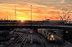 Battling Rays (brev99) Tags: d90 sigma1770os train sunset overpass starburst f22 tracks tulsa downtown sun photoshopelements18 topazclarity topazadjust colorefex