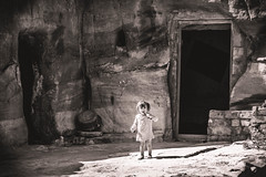 Nabatean Heritage. (icarium82) Tags: archaeology canoneos7d portrait child monochrome travel bw face jordan middleeast petra oldstones nabatean cavedwellers cave rocks bnw blackandwhite colortint sundaylights