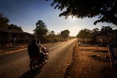 Heading west, Laos (pas le matin) Tags: travel voyage world road route landscape paysage laos lao asia asie sun soleil motorbike moto people canon 7d canon7d canoneos7d eos7d counterlight contrejour trees arbres bike motorcycle tree