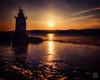 Tarrytown Light (brianloganphoto) Tags: sunet lighthouse blue historical winter landmark newyork waterskysunset tarrytown hudsonriver westchestercounty sparkpluglighthouse ice sleepyhollow unitedstates us