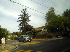 DSC01811 (classroomcamera) Tags: car home drive driving ride carride cross person man crossing intersection truck street streets road raods trees wire wires concrete yellow paint walk walking crosswalk