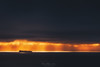 Light highway / Autopista de luz (Mimadeo) Tags: shipping ship freighter sea sunrays sunbeams sunbeamssky water landscape stormy ocean horizon cloud dark clouds seascape dramatic sunset cargo cargoship containership calm vessel nauticalvessel transportation transport container