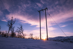 Power lines (asbjørnhbogstad) Tags: landscape winter ice cold north tromsø norway mountains sunset purple tint power lines pole tree nature human electricity