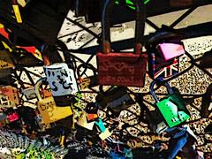 Unbreakable Love (Steve Taylor (Photography)) Tags: love heart lock padlock unionjack art digital memorial fence chainlinkfence colourful contrast metal rust uk gb england greatbritain unitedkingdom london gravel