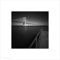 Vasco da Gama Bridge, Lisbon (Ian Bramham) Tags: vascodagama bridge lisbon portugal bw photo water sky