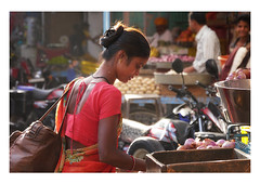in the light of late afternoon (handheld-films) Tags: india rajasthan portrait portraiture peple girl woman women shopping market softlight red indian subcontinent beauty beautiful