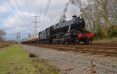 Heavyweight Loco 8F No.48624 on the 14.45 departure from Loughborough, passing Swithland Sidings and under the HT Pylons which dominate the area. Winter Steam Gala, Great Central Railway. 28 01 2018 (pnb511) Tags: loco locomotive locos locomotives steam smoke power track greatcentralrailway trains railway br 8f 48624