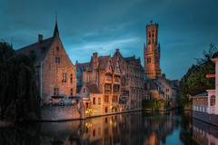 Belgium - Little Venice Corner in Bruge (Jacob Surland) Tags: architecture art belgium blue bluehour bruges brugge brügge building canal caughtinpixels city citybynight cityscape colors country fineart hdr highdynamicrange jacobsurland lamp lamps light medieval oldbuilding oldtower peaceful reflections tower towers warmlight water