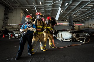 U.S. Navy Sailors fight a simulated aircraft fire during training.