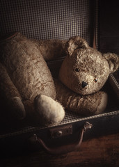 Well-Loved (AJWeiss71) Tags: teddybear teddy bear stilllife suitcase luggage vintage antique nostalgia nostalgic toy stuffedanimal stuffedtoy childhood mood moody headless damaged broken worn old brown memories abandoned timeless amyweiss