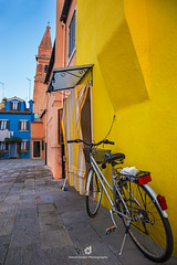 Colours of Burano (fesign) Tags: architecture basket bicycle bicyclebasket brightcolour building buildingexterior builtstructure burano city colourimage contrasts day door europe facade feature house italianculture italy multicoloured nopeople outdoors photography residentialbuilding sideview street transportation travel traveldestinations unescoworldheritagesite veneto veniceitaly wall washingline yellow