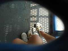 DSC00588 (classroomcamera) Tags: school campus table lunch hole blue framing subframing feet shoes sneakers girls friends together pair two pals light shadow shadows ground concrete blacktop daytime pose