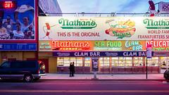 Nathan's Famous (deepaqua) Tags: brooklyn neon offseason hotdog coneyisland restaurant winter street storefront evening auto bluehour