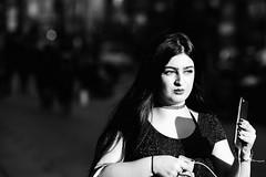 _MG_5209 (JetBlakInk) Tags: mono woman candid enigmatic monalisa light shadows streetphotography girl mobilephone