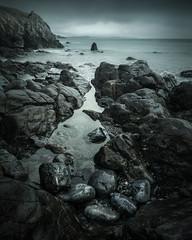 Ritual (jellyfire) Tags: coast distagont3518 landscape landscapephotography pebbles sea storm winter ze zeissdistagont18mmf35ze blue leeacaster pembrokeshire rocks stackpole stackpolequay wales wwwleeacastercom zeiss
