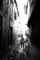 Children wanna have fun (Giulio Magnifico) Tags: mosul curiosity civilwar friends iraq da3sh leicaq leica alley street blackandwhite destroyed enjoy naturallight muslim diyarbakir child candid kurdish deepsoul iraqi iraqturchia middleeast children backlight streetphotography city ancient citylife italy bw happiness 28mm isis kurdistan yazidi architecture reportage littlegirl nikon