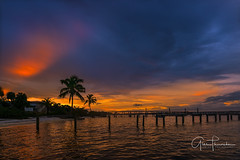 Florida Life: Painted Sky (Thūncher Photography) Tags: sony a7r2 sonya7r2 ilce7rm2 zeissfe1635mmf4zaoss fx fullframe scenic landscape waterscape sky clouds colors reflections shadows silhouettes sunset tropical beach palmtrees dock pier stuart florida martincounty southeastflorida