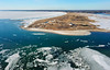 Stage Harbor Lighthouse and a Frozen Nantucket Sound (Chris Seufert) Tags: cape cod chahtam chatham stage harbor lighthouse frozen nantucket sound ocean sea winter drone aerial