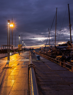 Boats and street lamps