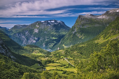 Down in the distance... (wimvandemeerendonk, back from Egypt!) Tags: geiranger geirangerfjord norway cloud clouds fjord hill hills landscape mountain mountainscape nature outdoors outdoor panorama rock rocks sony sky valley wimvandem water