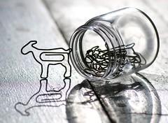 Goat Paperclips (dianne_stankiewicz) Tags: fasteners macro goat clip paperclip jar glass shadow hmm macromondays fastener wiry kids wire little shadows