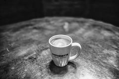 Coffee Coliseeum (brev99) Tags: d610 tonality macphun blackandwhite mug table steel bokeh wood antoinette antoinettesbakery sigma2414 cameracorrectionfilter nikviveza photoshopelements18