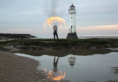 Fire Umbrella (David Chennell - DavidC.Photography) Tags: firespinning reflection wirral merseyside lightpainting newbrighton lighthouse perchrocklighthouse