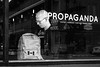 Self Titled (johnjackson808) Tags: chinatown propaganda flag window people reflections streetphotography backpack man monochrome bald fujifilmxt1 reataurant cafe penderst vancouver blackandwhite bw canada