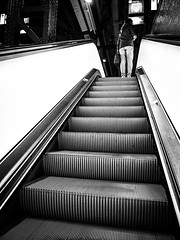 Reached the Top (Maarten Baars) Tags: blackwhite blackandwhite panasonicgx80 panasonic1235mmf28 microfourthirds mirrorless micro43 streetstory streetstyle street streetstories streetphotos streetphotography streetview urbanphotography amsterdamcentralstation amsterdam amsterdamcentraal escalator roltrap people