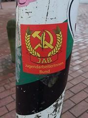 Hammer Sichel Feder (mkorsakov) Tags: münster city innenstadt sticker aufkleber jab jugendarbeiterinnenbund hammer sichel feder rotfront wtf