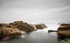 Bermagui headland (laurie.g.w) Tags: bermagui headland rocks water shoreline coastline seascape ocean sky cloud