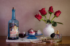 A toast to Betty Ann. (Phyllis Freels) Tags: bettyann councilbluffs iowa phyllisfreels antique blackberry blue bottle candy flowers glass indoor pearls perfume red roses stilllife tabletop tray vase vintage white wine