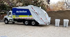 First Gear McNeilus Refuse truck. (Inner Blue Fire) Tags: firstgear freightlinerm2 freightliner mcneilus rearloader sanitation garbagetruck trashtruck refuse recycle