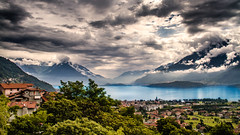 Lago di Como. (icarium.imagery) Tags: water canoneos7d landscape clouds travel nature landschaft reise wolken italy lagocomo dramaticclouds village lake sundaylights