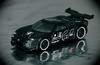 Ford, Race Car. (EOS) (Mega-Magpie) Tags: canon eos 60d indoors car toy ford race black reflections vignetting mattel hot wheels gt