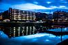 Evening lights in the city (Maria Eklind) Tags: bluehour bridge street water spegling city rörsjökanalen dusk canal bro malmö amiralsbron sky twilight blue kanal reflection building södraförstadskanalen sweden streetsofmalmö skånelän sverige se skyscraper architecture