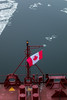Fairleads and Flags (langdon10) Tags: canada canadianflag canon70d laurentiadesgagnes montreal quebec ship stlawrenceriver tanker anchorlight cold nautical winter