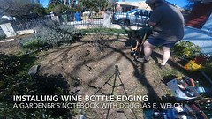 Installing Wine Bottle Edging Timelapse From A Gardener's Notebook [Video] (1:38) Watch the entire video at WelchWrite.com/agn Saturday gave some time to finally install a circle of wine bottle edging to a bed we have been meaning to clean up for a long t (dewelch) Tags: ifttt instagram installing wine bottle edging timelapse from a gardener's notebook video 138 watch entire welchwritecomagn saturday gave some time finally install circle bed we have been meaning clean up for long this is third edged fashion garden diy howto project reuse recycle bottles winebottles
